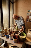 Ian Hird of Kelso Pottery in his workshop, Kelso, Scottish Borders.  Picture Credit: Paul Tomkins / VisitScotland / Scottish Viewpoint Tel: +44 (0) 131 622 7174   Fax: +44 (0) 131 622 7175 E-Mail : in... Public, MR 2011,interior,craft,crafts,skill,potter,potters,wheel,people