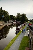 The Linlithgow Canal Centre, on the Edinburgh and Glasgow Union Canal, Linlithgow, West Lothian. Picture Credit : Paul Tomkins / VisitScotland / Scottish Viewpoint Tel: +44 (0) 131 622 7174   E-Mail :... Public 2011,summer,attraction,visitor,narrow,boats,long,towpath,people,walking,activity,barge,barges,water