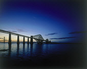 LOOKING OVER, FROM THE SOUTH SIDE OF THE FIRTH OF FORTH, TO THE FORTH RAIL BRIDGE- BUILT BETWEEN 1883-90 FROM A DESIGN BY JOHN FOWLER WITH THE ROAD BRIDGE BEHIND AT SUNSET, EDINBURGH. PIC: P.TOMKINS/V... STRUCTURE,DRAMATIC,TRANSPORT,ATMOSPHERIC,ENGINEERING