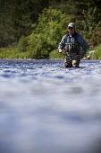 An angler at the Lower Crathes / West Durris fishing beat on the River Dee, near Banchory, Aberdeenshire.Picture Credit : Paul Tomkins / VisitScotland / Scottish ViewpointTel: +44 (0) 131 622 7174  E-... Public, MR 2011,summer,sunny,angling,fish,salmon,rod,water,activity,waders