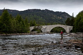 An angler fishing in the pool on the Crathie Beat below the Brig o' Dee, River Dee, near Braemar, Aberdeenshire. Picture Credit : Paul Tomkins / VisitScotland / Scottish Viewpoint Tel: +44 (0) 131 622... Public, MR 2011,summer,angling,fish,water,activity,rod,cast,casting,invercauld,bridge