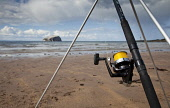 Sea angling at Seacliff beach with a view beyond to the Bass Rock, near North Berwick, East Lothian. Picture Credit : Paul Tomkins / VisitScotland / Scottish Viewpoint Tel: +44 (0) 131 622 7174   E-Ma... Public 2011,summer,sunny,fish,fishing,water,activity,rod,reel,sand,sandy,coast,coastal