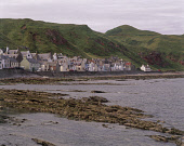 LOOKING ACROSS THE ROCKY FORESHORE TO COTTAGES LINING THE SEAFRONT AT GARDENSTOWN- A FISHING VILLAGE ON GAMRIE BAY ON THE NORTH COAST, ABERDEENSHIRE. PIC: P.TOMKINS/VisitScotland/SCOTTISH VIEWPOINT Te... WATER,HOUSE,PEOPLE,HOUSING,SUMMER