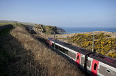 A Cross Country train on the east coast railway line at Lamberton, just north of the England - Scotland Border, Scottish Borders. Picture Credit : Paul Tomkins / VisitScotland / Scottish Viewpoint  Te... Public 2012,spring,sunny,coastal,coast,north,sea,berwickshire,travel,transport,public,route,cliffs,dramatic,crosscountry