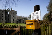 The honesty box at Castle Kennedy Gardens with the ruins of Castle Kennedy visible behind, near Stranraer, Dumfries and Galloway.  Picture Credit : Paul Tomkins / VisitScotland / Scottish Viewpoint  T... Public 2012,spring,sunny,attraction,visitor,garden,gounds,flowers,lochinch