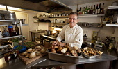 Jimmy Graham, chef / proprietor of Ostler's Close Restaurant - one of Scotland's premier dining experiences, serving the best of local and Scottish seasonal ingredients, Cupar, Fife. Picture Credit :... Public 2011,interior,kitchen,cook,cooking,mushrooms,fungi,ingredients,smile,people,food,eating