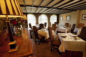 The main dining room of The Peat Inn restaurant with rooms, near St Andrews, Fife. Picture Credit : Paul Tomkins / VisitScotland / Scottish Viewpoint  Tel: +44 (0) 131 622 7174  E-Mail : info@scottish... Public 2011,interior,room,plate,place,setting,glass,cutlery,table,dining,food,eating