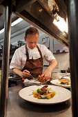 Geoffrey Smeddle, Michelin starred and award winning chef / proprietor of The Peat Inn restaurant with rooms, at work in the kitchen, by St Andrews, Fife. Picture Credit : Paul Tomkins / VisitScotland... Public 2011,interior,cook,cooking,food,eating,prepare,preparation
