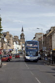 Cupar - a small market town and former Royal Burgh in the heart of  the Howe of Fife.  Picture Credit : Paul Tomkins / VisitScotland / Scottish Viewpoint  Tel: +44 (0) 131 622 7174  E-Mail : info@scot... Public 2011,summer,sunny,shops,retail,bus,local,transport,clock,tower,street,corn,exchange,cars,traffic,parked