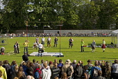 The Weight Over the Bar competition at the Inverness Highland Games, held in the Northern Meeting Park, Inverness, Scottish Highlands.  Picture Credit : Paul Tomkins / VisitScotland / Scottish Viewpoi... Public, NMR 2011,summer,sunny,event,visitor,attraction,city,audience,crowd,crowds,spectators,heavy,heavies,tartan,kilt,throw,people,competitor