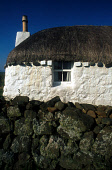 A DETAIL OF THE CHIMNEY POT AND WINDOW OF A THATCHED CROFT ON THE ISLAND OF SKYE, INNER HEBRIDES. PIC: VisitScotland/SCOTTISH VIEWPOINT Tel: +44 (0) 131 622 7174   Fax: +44 (0) 131 622 7175 E-Mail : i... DRYSTONE WALL,HOUSE,COMMUNITY,HOUSING,WHITE WASH,BUILDING