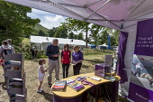 VisitScotland's Information booth at The Big Tent - Scotland's Environmental Festival, a unique green, music, arts and family festival held at Falkland, Fife. Picture Credit : Paul Tomkins / VisitScot... Public 2012,summer,sunny,event,attraction,VIC,mobile,stall,visitor,tourist,tourism,people,help,advice,family,child