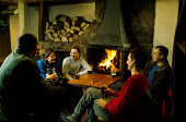 HILLWALKERS ENJOY A DRINK AND A CHAT IN FRONT OF A LOG FIRE AT THE CLACHAIG INN, GLEN COE, HIGHLAND. PIC: PAUL TOMKINS/VisitScotland/SCOTTISH VIEWPOINT Tel: +44 (0) 131 622 7174   Fax: +44 (0) 131 622... HOSPITALITY,SMILE,CLIMBERS,PEOPLE