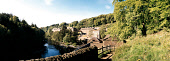 LOOKING DOWN ON NEW LANARK WORLD HERITAGE SITE SOUTH LANARKSHIRE. PIC: VisitScotland/SCOTTISH VIEWPOINT Tel: +44 (0) 131 622 7174   Fax: +44 (0) 131 622 7175 E-Mail : info@scottishviewpoint.com This p... RIVER CLYDE,BUILDING,SUNNY,WATER,EXHIBIT,ARCHITECTURE,AUTUMN