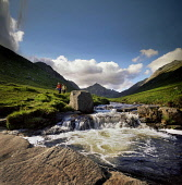 Walkers by the side of the fast flowing Glenrosa Water in Glen Rosa on the Isle of Arran, North Ayrshire. Pic : P.Tomkins / VisitScotland / SCOTTISH VIEWPOINT Tel: +44 (0) 131 622 7174  E-Mail : info@... Public 2006,summer,atmospheric,river,leisure,activity,people,walking,couple,mountain,mountains,hill,hills,island