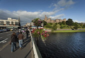Inverness Castle and River Ness, Inverness, Highlands of Scotland.  Picture Credit : Paul Tomkins / VisitScotland / Scottish Viewpoint  Tel: +44 (0) 131 622 7174  E-Mail : info@scottishviewpoint.com... Public 2012,summer,sunny,people,city,water,bridge,floral,display,flowers,attraction,visitor,tourist,highland