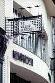 LOOKING UP AT THE STYLISED EXTERIOR FACADE OF THE WILLOW TEA ROOMS, SAUCHIEHALL STREET, DESIGNED BY CHARLES RENNIE MACKINTOSH (PERHAPS GLASGOW'S MOST DISTINGUISHED ARCHITECT B.1868 D.1928), IN THE CIT... SIGN,DETAIL,DRINKING,STYLE,DESIGN,EATING,CAFE,HERITAGE