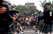 PIPERS OF A PIPE BAND MARCH ALONG PRINCES STREET (WITH THE CASTLE VISIBLE BEHIND) WHILST TAKING PART IN THE ANNUAL FESTIVAL FRINGE CAVALCADE, EDINBURGH. *** Please be aware that this event no longer... CROWD,SUMMER,EVENT,TARTAN,KILT,PIPER,PEOPLE,BAGPIPES