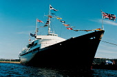 LOOKING OVER TO THE ROYAL YACHT BRITANNIA MOORED AT LEITH DOCKS, LEITH- THE PORT OF THE CITY OF EDINBURGH. PIC: YACHT EVENTS LTD/SCOTTISH VIEWPOINT Tel: +44 (0) 131 622 7174   Fax: +44 (0) 131 622 717... WATER,SUMMER,BOAT,FLAGS