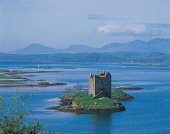 LOOKING ACROSS LOCH LAICH (AN INLET OFF LOCH LINNHE VISIBLE BEHIND) OVER TO CASTLE STALKER- DATING FROM THE 15C WHEN IT WAS ORIGINALLY BUILT FOR JAMES IV, WITH THE HILLS OF MORVERN IN THE DISTANCE, AR... MOUNTAIN,SUNNY,BUILDING,HERITAGE,WATER,SUMMER,ARCHITECTURE