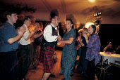 """REVELLERS AT A CEILIDH PARTICIPATE IN AN ENERGETIC BUT ENJOYABLE REEL OF """"STRIP THE WILLOW"""" DURING CELTIC CONNECTIONS IN GLASGOW. PIC: P.TOMKINS/VisitScotland/SCOTTISH VIEWPOINT Tel: +44 (0) 131 622 7... KILT,DANCE,SMILE,EVENT,TRADITION,TARTAN,PEOPLE"""