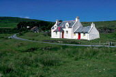 A WHITE WASHED COTTAGE WITH BRIGHTLY PAINTED RED DOORS AT GLENDALE SOUTH OF DUNVEGAN HEAD, ISLE OF SKYE, INNER HEBRIDES. PIC: VisitScotland/SCOTTISH VIEWPOINT Tel: +44 (0) 131 622 7174   Fax: +44 (0)... SUMMER,SUNNY,CROFT,ROAD,TREE