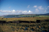 LOOKING OVER LOCH DUNVEGAN TO THE VILLAGE OF DUNVEGAN FROM THE WEST SHORE WITH EVIDENCE OF PEAT CUTTING IN THE FOREGROUND, ISLE OF SKYE, INNER HEBRIDES. PIC: P.TOMKINS/VisitScotland/SCOTTISH VIEWPOINT... SUMMER,SUNNY,CROFT,FORESTRY,COAST,WATER,CHURCH,FUEL