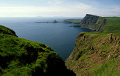 LOOKING ALONG RUGGED COASTLINE AT NEIST POINT, THE MOST WESTERLY POINT ON THE ISLE OF SKYE, INNER HEBRIDES. PIC: P.TOMKINS/VisitScotland/SCOTTISH VIEWPOINT Tel: +44 (0) 131 622 7174   Fax: +44 (0) 131... SUMMER,SUNNY,COAST,WATER,CLIFF,LIGHTHOUSE