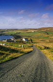 A PERSON WALKS UP A SINGLE TRACK ROAD THROUGH A DISPERSED CROFTING SETTLEMENT ON THE COAST,  THE ISLE OF SKYE, INNER HEBRIDES. PIC: P.TOMKINS/VisitScotland/SCOTTISH VIEWPOINT Tel: +44 (0) 131 622 7174... SUMMER,SUNNY,WATER,COMMUNITY,FARMING,SHEEP,PEOPLE