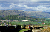 LOOKING ACROSS STIRLING OVER TO THE WALLACE MONUMENT FROM THE BATTLEMENTS OF THE CASTLE,  PIC: VisitScotland/SCOTTISH VIEWPOINT Tel: +44 (0) 131 622 7174   Fax: +44 (0) 131 622 7175 E-Mail : info@scot... SUMMER,MEMORIAL,COUPLE,ARCHITECTURE,HERITAGE,HISTORIC SCOTLAND,PEOPLE,SUNNY