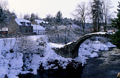 THE REMAINS OF THE OLD BRIDGE ACROSS THE RIVER DULNAIN WITH COTTAGES VISIBLE BEHIND AT THE VILLAGE OF CARRBRIDGE IN THE BADENOCH AND SPEYSIDE DISTRICT, HIGHLAND. PIC: VisitScotland/SCOTTISH VIEWPOINT... WINTER,LAMPOST,HOUSE,BUILDING,SNOW,SUNNY