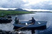 TWO FISHERMEN IN A SMALL BOAT ON LOCH FADA, SOUTH UIST, OUTER HEBRIDES. PIC: P.TOMKINS/VisitScotland/SCOTTISH VIEWPOINT Tel: +44 (0) 131 622 7174   Fax: +44 (0) 131 622 7175 E-Mail : info@scottishview... WATER,SUNNY,SUMMER,PEOPLE,ACTIVITY,GAME,FLY,ANGLING