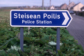 A DETAIL OF THE GAELIC / ENGLISH INFORMATION SIGN FOR THE POLICE STATION ( STEISEAN POILIS) AT LIONAL, ISLE OF LEWIS, OUTER HEBRIDES. PIC: P.TOMKINS/VisitScotland/SCOTTISH VIEWPOINT Tel: +44 (0) 131 6... SUMMER,DIRECTIONS,INFORMATION,LANGUAGE