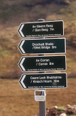 LOOKING OVER TO VARIOUS PUBLIC FOOTPATH SIGNS IN BOTH GAELIC AND ENGLISH (FOR GLEN BEAG, SHIEL BRIDGE, CORRAN AND KINLOCH HOURN) PUT UP BY THE SCOTTISH RIGHTS OF WAY AND ACCESS SOCIETY AND ALSO BY FUN... AUTUMN,ACTIVITY,WALKING,RIGHT OF WAY,DIRECTIONS,SIGNAGE,SIGN