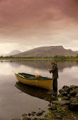 A FISHERMAN STANDS BY A SMALL BOAT ON THE SHORE OF LOCH AWE PREPARING TO GO OUT AND FISH, WEST OF DALMALLY, ARGYLL AND BUTE. PIC: PAUL TOMKINS/VisitScotland/SCOTTISH VIEWPOINT Tel: +44 (0) 131 622 717... ACTIVITY,PEOPLE,SPORT,FISH,FISHING,ATMOSPHERIC,AUTUMN,MIST