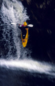 A WHITEWATER KAYAKER MAKES A DRAMMATIC PLUNGE OVER RIGHT ANGLE FALLS IN GLEN ETIVE- A STEEP SIDED VALLEY CARRYING THE RIVER ETIVE SOUTH WEST TO LOCH ETIVE, THE LOCHABER DISTRICT, HIGHLAND. PIC: P.TOMK... 2003,WHITE WATER,WATERFALL,WATER,PADDLE,KAYAK,EXTREME SPORT,BLUR BLURRY,ACTIVITY