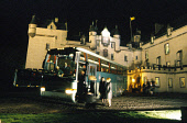 DELEGATES BOARD A COACH AFTER A GALA DINNER WHICH WAS PART OF A BUSINESS TOURISM WORKSHOP AT FYVIE CASTLE, NORTH OF OLDMELDRUM, ABERDEENSHIRE. PIC: P.TOMKINS/VisitScotland/SCOTTISH VIEWPOINT Tel: +44... ATMOSPHERIC,SMB,SCOTLAND MEANS BUSINESS,NIGHT,LEAVING,LEAVE,FLOODLIT,DARK,BTU