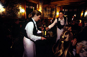 WAITRESSES SERVE WHISKY AND LIQUEURS AT A GALA DINNER DURING A BUSINESS TOURISM WORKSHOP AT FYVIE CASTLE, NORTH OF OLDMELDRUM, ABERDEENSHIRE. PIC: P.TOMKINS/VisitScotland/SCOTTISH VIEWPOINT Tel: +44 (... BOTTLE,WAITRESS,SMILE,SMB,SCOTLAND MEANS BUSINESS,INTERIOR,GLASSES,GLASS,EATING,DRINKING,DRAM,BTU