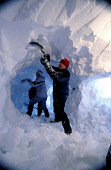 TEAM MEMBERS DIG A SNOW HOLE INTO THE NORTH EAST FLANK OF BEN MACDUI IN THE CAIRNGORM NATIONAL PARK DURING A MOUNTAIN INNOVATIONS WINTER SKILLS TRAINING COURSE AND SNOW HOLE EXPEDITION, HIGHLAND. PIC:... 2004,WINTER,SNOWHOLING,SNOWHOLE,MUNRO,MOUNTAINEERING,MOUNTAIN,INTERIOR,ICE,HOLING,HILL WALKING,HILL WALKER,EXTREME,COMMUNAL,CLIMBING,CAMP,CAIRNGORMS,ADVENTURE,ACTIVITY,ACCOMMODATION