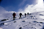A GROUP OF WALKERS CLIMBING IN THE CAIRNGORM NATIONAL PARK DURING A MOUNTAIN INNOVATIONS WINTER SKILLS TRAINING COURSE AND SNOW HOLE EXPEDITION, HIGHLAND.PIC: P.TOMKINS/VisitScotland/SCOTTISH VIEWPOIN... 2004,WINTER,WALK,SUNNY,SNOW,RUCKSACKS,RUCKSACK,MOUNTAINS,MOUNTAINEERING,MOUNTAIN,HILL WALKING,HILL WALKER,EXTREME,CLIMBING,CAIRNGORMS,ADVENTURE,ACTIVITY