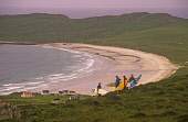 A GROUP OF SURFERS WITH THEIR BOARDS STAND ON A HILLSIDE ABOVE BALEPHUIL BAY, THE ISLE OF TIREE, INNER HEBRIDES.  PIC: P. TOMKINS/VisitScotland/SCOTTISH VIEWPOINT Tel: +44 (0) 131 622 7174   Fax: +44... 2004,WATER,SURFING,SURFBOARDS,SURFBOARD,SPORTS,SANDY,SAND,ISLAND,EXTREME,EQUIPMENT,COAST,BEN HYNISH,BEACH,ACTIVITY