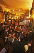 """THE """"MIKE VASS BAND"""" LEAD AN EVENING SESSION OF LIVE TRADITIONAL MUSIC IN THE ROYAL MILE TAVERN AS PART OF THE MCEWAN'S SESSIONS, EDINBURGH FESTIVAL 2004, EDINBURGH, LOTHIAN. PIC: P.TOMKINS/VisitScotl... ACCORDIAN,VIOLIN,PUB,PEOPLE,MUSICIANS,MUSIC,INTERIOR,FIDDLERS,FIDDLE,EVENT,DRINK DRINKING,BAR"""
