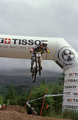 JUMPING THROUGH THE TISSOT ARCH ON THE DOWNHILL COURSE DURING THE 2004 MOUNTAIN BIKE WORLD CUP AT NEVIS RANGE, NEAR FORT WILLIAM, HIGHLAND. PIC: P. TOMKINS/VisitScotland/SCOTTISH VIEWPOINT Tel: +44 (0... 2004,SPORT,EVENT,CYCLIST,CYCLING,CYCLE,COMPETITION,ACTIVITY