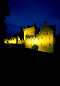 """LOOKING OVER TO A FLOODLIT CAWDOR CASTLE (DATING FROM 1342 AND FAMED FOR ITS ASSOCIATION WITH """"MACBETH"""" AND ALSO THE NOTABLE GARDENS), AT NIGHT, SOUTH WEST OF NAIRN, HIGHLAND. PIC: P.TOMKINS/VisitScot... HERITAGE,DRAMATIC,ATMOSPHERIC,ARCHITECTURE,HOUSE,BUILDING"""