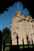 LOOKING THROUGH A GATEWAY TO CRATHES CASTLE- A TURRETED TOWER HOUSE DATING FROM THE 16C WITH 17C AND 19C EXTENSIONS, EAST OF BANCHORY, ABERDEENSHIRE.PIC: P.TOMKINS/VisitScotland/SCOTTISH VIEWPOINTTel:... HERITAGE,BUILDING,ARCHITECTURE,NATIONAL TRUST FOR SCOTLAND,HEDGE,GARDEN,GARDENS