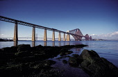 THE FORTH RAIL BRIDGE- BUILT BETWEEN 1883-90 FROM A DESIGN BY JOHN FOWLER, FROM THE SOUTH SHORE OF THE FIRTH OF FORTH WITH THE ROAD BRIDGE VISIBLE BEHIND, EDINBURGH. PIC: P.TOMKINS/VisitScotland/SCOTT... COAST,WATER,TRANSPORT,SUNNY,SUMMER,STRUCTURE,SOUTH QUEENSFERRY,NORTH QUEENSFERRY,ENGINEERING