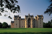 LOOKING ACROSS PARKLAND TO FYVIE CASTLE- DATING FROM THE 13C AND ONE OF THE STATELIEST CASTELLATED MANSIONS IN SCOTLAND, NORTH OF OLDMELDRUM, ABERDEENSHIRE. PIC: P.TOMKINS/VisitScotland/SCOTTISH VIEWP... ARCHITECTURE,SUNNY,SUMMER,PEOPLE,NATIONAL TRUST FOR SCOTLAND,HERITAGE,FLAG,BUILDING