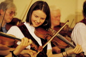 """A YOUNGER MEMBER OF THE """"SHETLAND FIDDLERS"""" ENJOYS PERFORMING IN A CONCERT AT LERWICK- THE CHIEF TOWN ON THE SHETLAND ISLES . PIC: P.TOMKINS/VisitScotland/SCOTTISH VIEWPOINT Tel: +44 (0) 131 622 7174... FIDDLE,VIOLIN,TRADITIONAL,SMILE,PERFORMANCE,PEOPLE,MUSIC,ISLES,INSTRUMENT,FOLK"""
