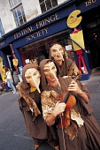 """THE CAST OF """"TIGER'S BRIDE""""- A FRINGE SHOW PERFORMING DURING THE FESTIVAL, POSE FOR A PHOTOGRAPH OUTSIDE THE FESTIVAL FRINGE SOCIETY OFFICE ON THE ROYAL MILE DURING THE FESTIVAL, IN THE CITY CENTRE OF... 2003,SUMMER,PEOPLE,MUSICAL INSTRUMENT,MASK MASKS,CULTURE,COSTUME,ART,ACTORS ACTING"""