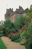 THE MAINLY VICTORIAN (ALTHOUGH SOME PARTS DATE BACK TO THE 13C) BRODICK CASTLE, FAMED FOR ITS RHODODENDRON COLLECTION AND WOODLAND GARDEN), ISLE OF ARRAN. PIC: PAUL TOMKINS/VisitScotland/SCOTTISH VIEW... ARCHITECTURE,SUMMER,NATIONAL TRUST FOR SCOTLAND,HORTICULTURE,GARDENS,FLOWERS,FLAG,BUILDING,BOTANICS